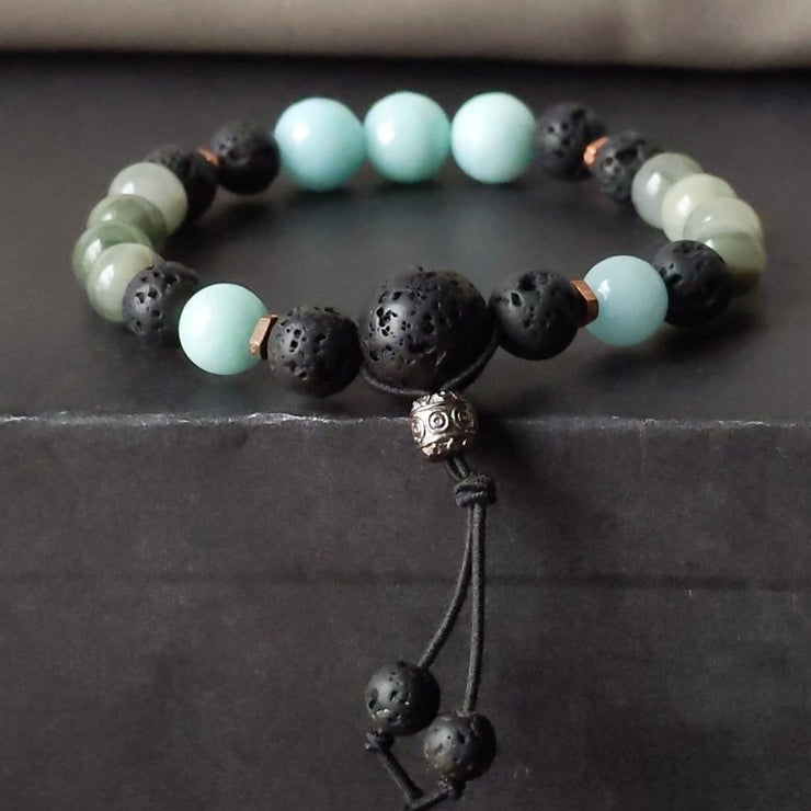 blue and green gemstone stretch bracelet with copper and essential oil diffusing lava beads