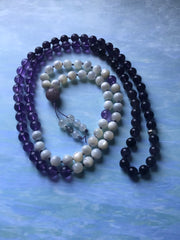 Gem quality amethyst with iridescent ivory mother of pearl and one tasteful sterling silver marker bead necklace