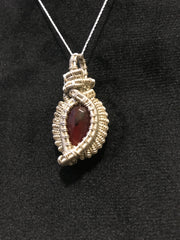 red faceted agate gemstone crystal handwrapped in 925 sterling silver wire pendant