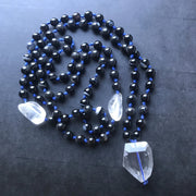 Black stripe agate and clear crystal quartz on blue hand knotted necklace