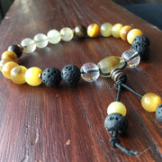 gold hair rutile quartz yellow tigereye black lave stone clear crystal quartz copper spacer beads on black stretch cord natural gemstone crystal stretch bracelet