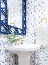 Load image into Gallery viewer, powder room, navy mirror powder room, blue mirror powder room, wicker mirror bathroom, rattan mirror bathroom, navy white bathroom, navy white powder room, half bath remodel