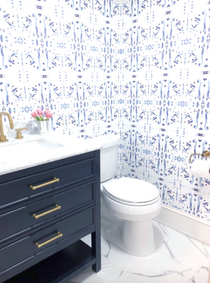 navy and white powder room, navy and white wallpaper bathroom, navy vanity bathroom, navy sink cabinet, white and navy small bathroom