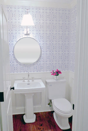 Powder room wallpaper pedestal sink small bathroom half bath round mirror adjustable arm wall sconce polished nickel wainscoting kohler purist wood floors white and blue