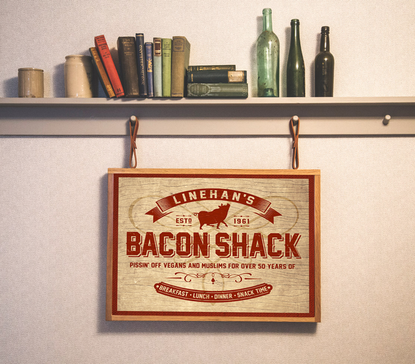 Your bacon shack, personalized poster print, canvas print, displayed in brown frame, cream color background, books on a shelf.