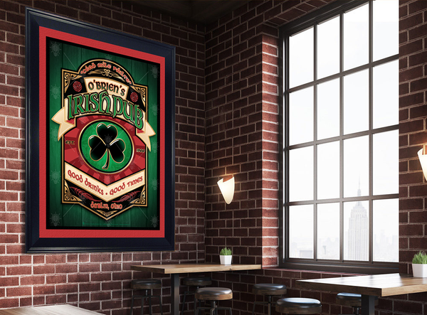 Black shamrock, personalized Irish pub, poster print, canvas print, framed print, shown with red and black mats, in a black frame, mounted on a brick wall, large window with tables.