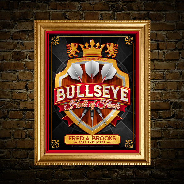 Bullseye Hall of Fame Darts print, canvas print, framed print, displayed on a rustic brick wall with red mat and golden frame.