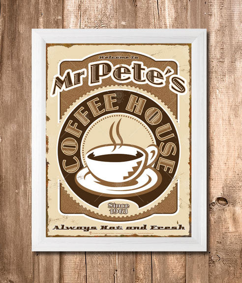The coffee house sign print, vintage and retro style theme, displayed in a white simple frame, backround is vertical wooden plank wall.