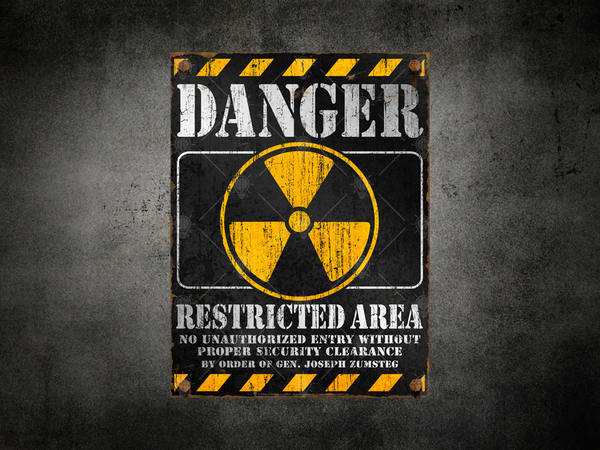 Danger Restricted Area warning sign, personalized poster, canvas print, shown displayed on rustic dark grey wall background.