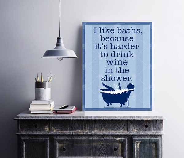 I like baths because it's harder to drink wine in the shower, poster print, canvas print, displayed in a wood frame, white wall, vanity, hanging lamp.
