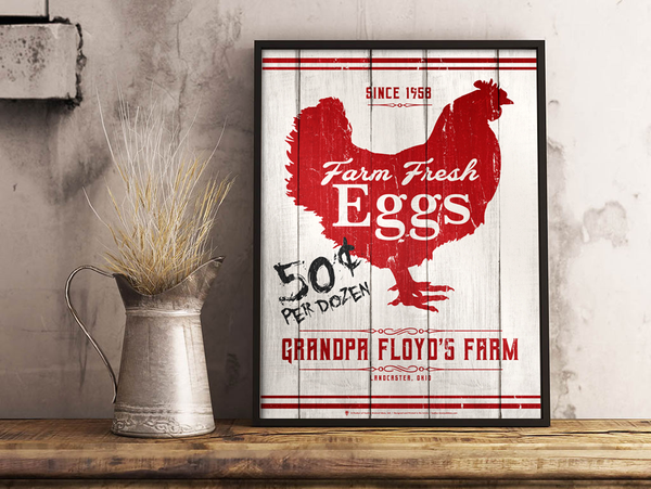 Personalized Farm Fresh Eggs sign, poster print, canvas print, shown displayed in black poster frame, white rustic wall background, metal pitcher, dried grass, wood table top.