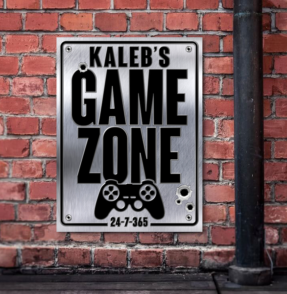 Game zone personalized sign, poster print, canvas print, shown mounted on old rustic red brick wall, black pipe.
