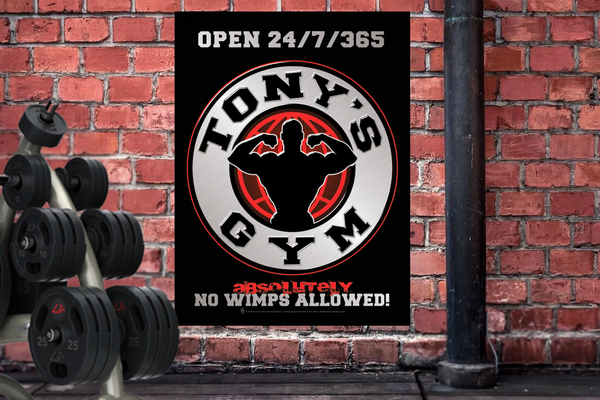 Your gym, no wimps allowed, personalized poster print, canvas print, shown in black frame, mounted on old brick wall, weight equipment in room.