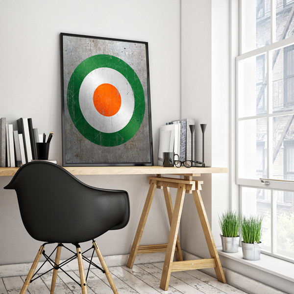 Old Irish air force symbol, poster print, canvas print, shown displayed in black poster frame, work space with white wall, desk, black chair.