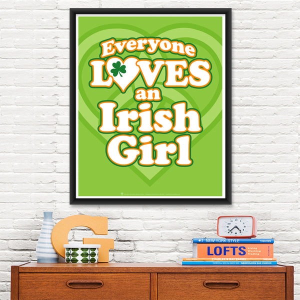 Everyone Loves an Irish Girl, poster print, canvas print, shown displayed in a black poster frame, mounted on a white brick wall, wood desk, kids books, alarm clock.