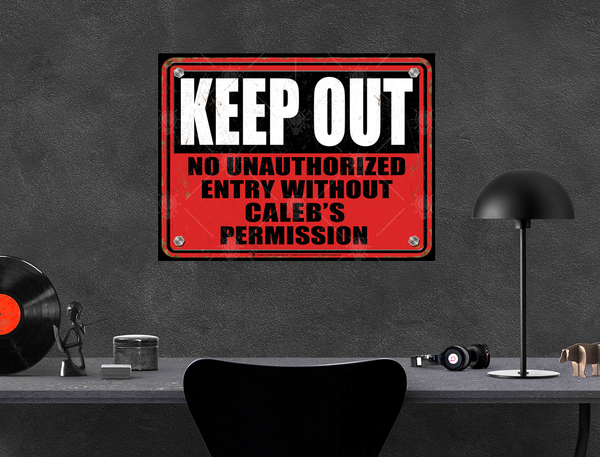 Keep out personalized warning sign, poster print, canvas print, displayed on dark grey wall, work station, home office.