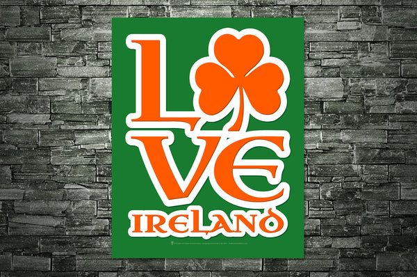Love Ireland, poster print, canvas print, green background, lettering orange with white outline, shown mounted on old brick wall