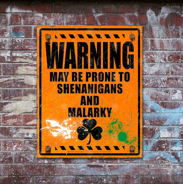 Warning may be prone to shenanigans and malarky, Irish poster print, canvas print, shown mounted on rustic brick wall with graffiti markings.