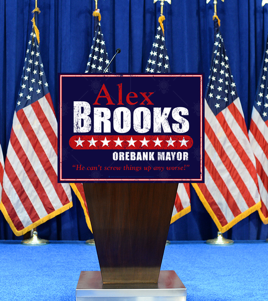 The moderate, personalized faux political campaign poster print, shown displayed on speaker podium, American flags and blue curtain in background.