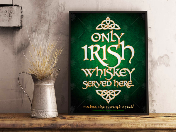 Only Irish whiskey served here, Irish pub and bar poster print, canvas print, shown displayed in a brown frame, grey plaster wall, siver pitcher, wood table.