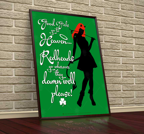 Red heads, funny Irish poster print, canvas print, shown displayed in a black frame, leaning on vintage style brick wall, dark hardwood floor.