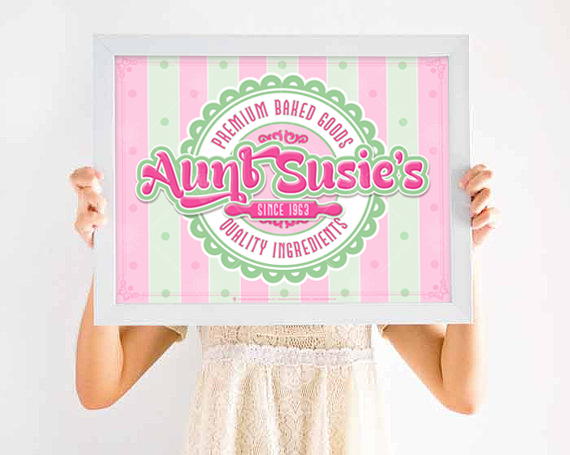 Premium baked goods, personalized poster print, canvas print, shown in white wood frame, little girl holding up final product.