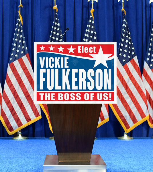 the boss of us, personalized political campaign poster, canvas print, displayed on podium, american flags in background.