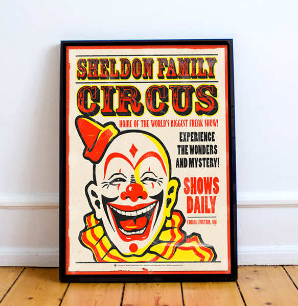 Personalized Family Circus poster print, canvas print, shown displayed in black poster frame, leaning on white wall, hardwood floor.