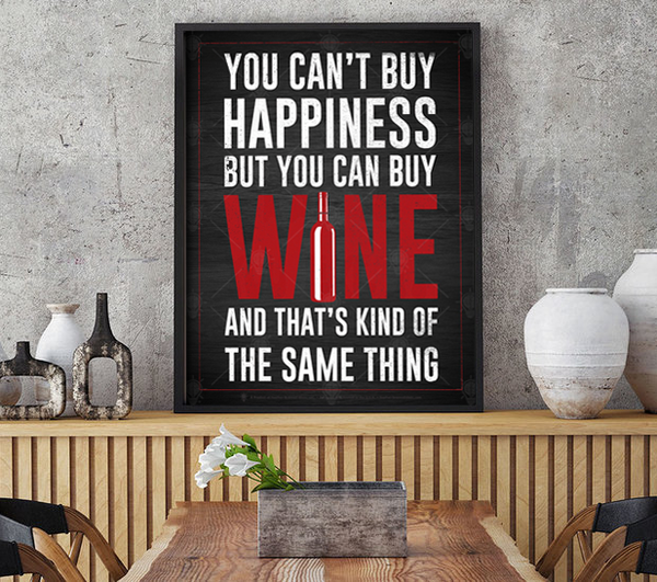 You can't buy happiness but you can buy wine, poster print, canvas print, shown displayed in a black frame on a grey wall, dining area, kitchen.