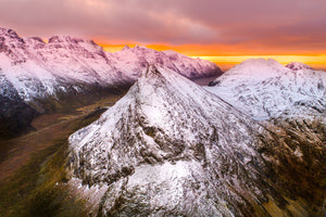 Beautiful Aerial Drone Norway Arctic circle snow cap mountians and unrise with the mountian Aeroture Michael Haluwana
