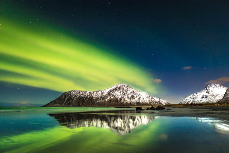 Northern Lights Aurora Reflection on the water and mountain Arctic tours by Aeroture Michael Haluwana