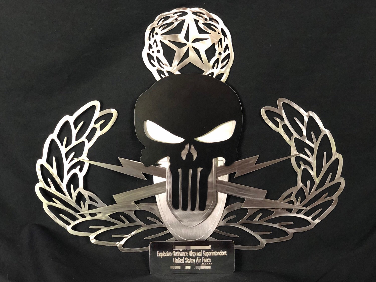 metal sign with eod logo and punisher skull