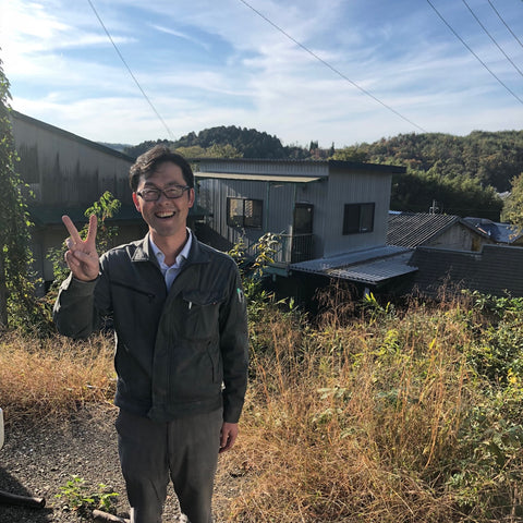 Suzuki-san in front of his factory in the mountains of Tajimi