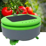 Tertill the weeding robot in a tomato garden.