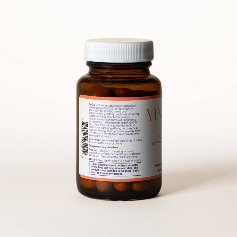 List of ingredients for CoEnzyme Q10 tablets on the back of a clear brown bottle