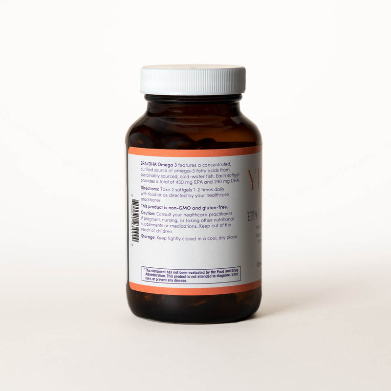 List of ingredients for Yinova's Blend of EPA/DHA Omega 3 tablets on the back of a clear brown bottle.