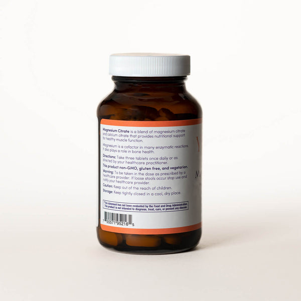 List of ingredients for Magnesium Citrate tablets on the back of a clear brown bottle.