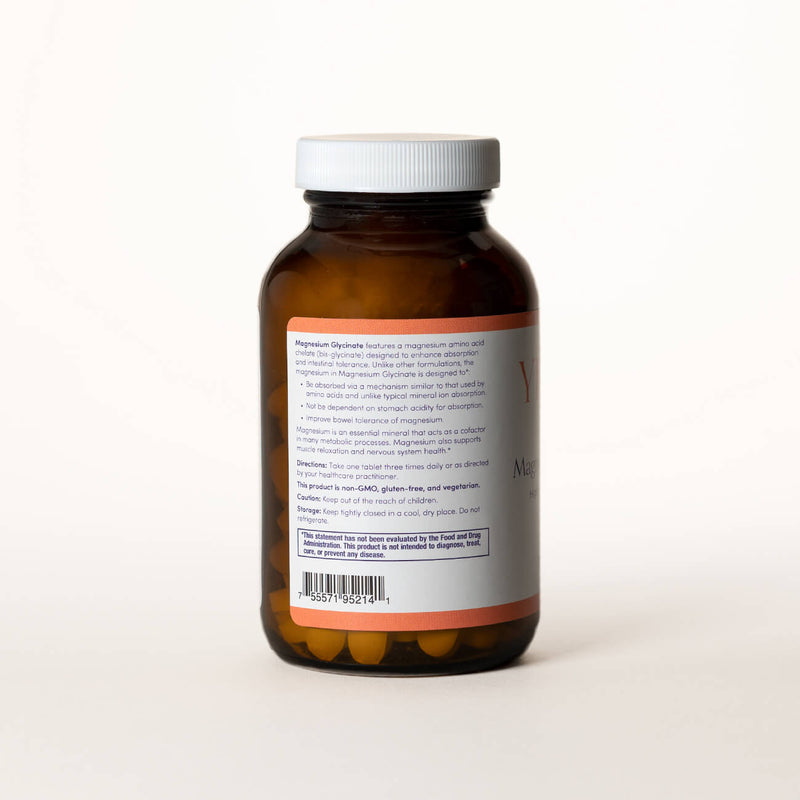 List of ingredients for Magnesium Glycinate tablets on the back of a clear brown bottle.