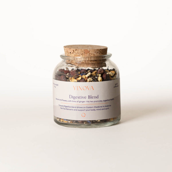 Clear bottle with a cork lid containing Yinova's herbal tea blend for digestion