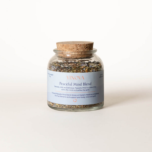Clear bottle with a cork lid containing Yinova's herbal tea blend for relaxation