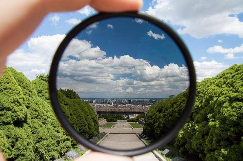 A polarized filter does more then just protect your lens, Use it to get rid of ugly glare.