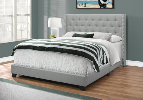 Queen Size Bed With A Chrome Trim