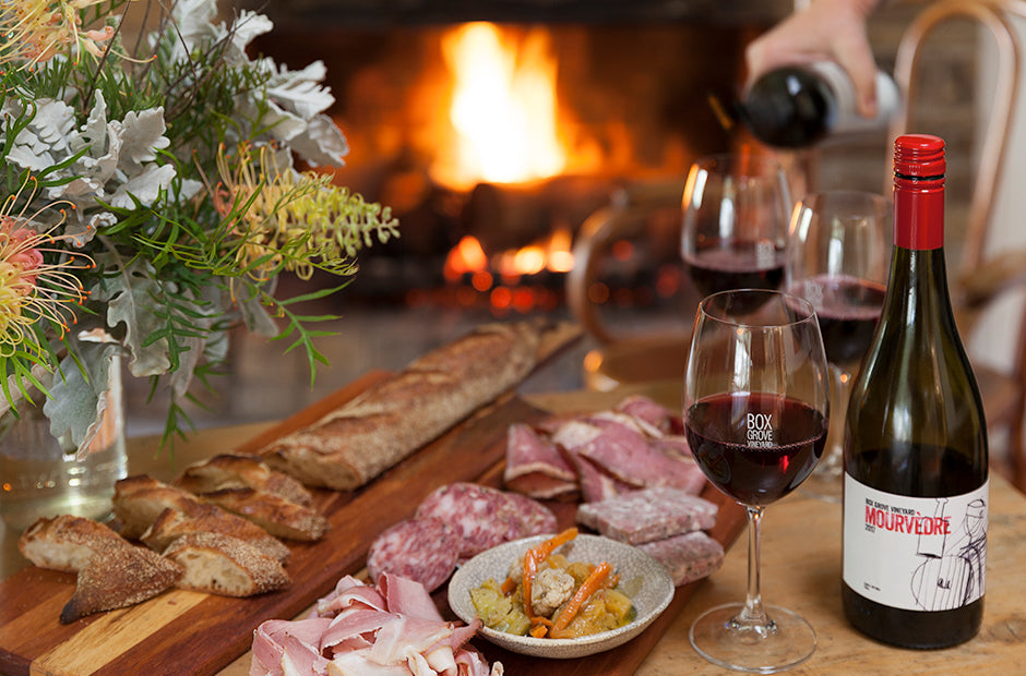 Serving food and wine by the fire at The Osteria.