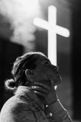 Photo by KEEM IBARRA on Unsplash woman standing in front of a white cross