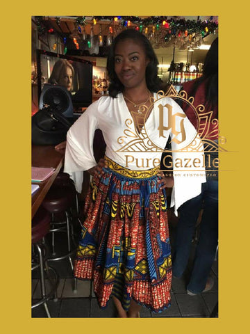 Happy Woman modeling Pure Gazelle custom African Print skirt in red and blue