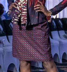 Model wearing fitted Aline skirt in African Print.