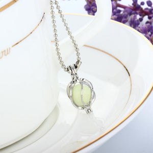 Light Blue Glow in the Dark Running Abstract Ball Pendant Necklace