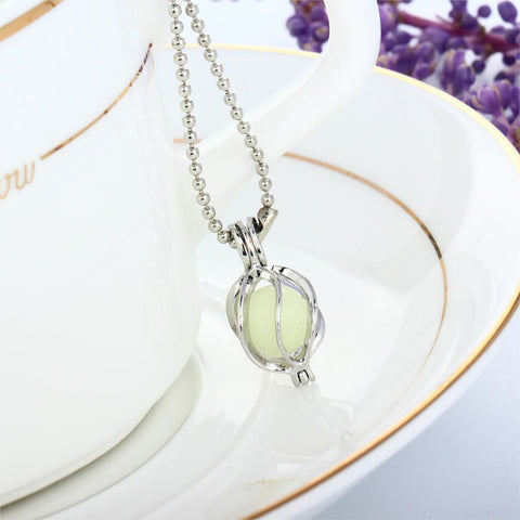 Image of Light Blue Glow in the Dark Running Abstract Ball Pendant Necklace