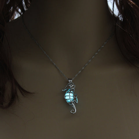 Image of Blue Green Glow In The Dark Hollow Seahorse Pendant Necklace