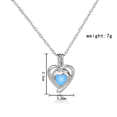 Image of Blue Green Glow in the Dark Running Heart Shape Necklace
